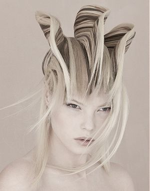 A long blonde straight coloured plaited sculptured avant garde hairstyle by seanhanna