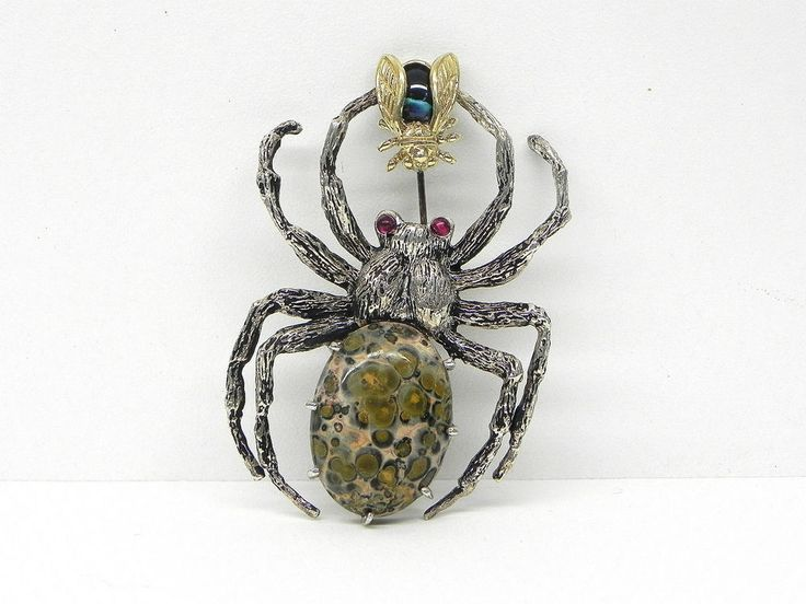 $395   Up for sale is this beautifully made Tarantula eating fly sterling silver and 14kt brooch. The piece is set with a large brown color cabochon cut stone, a blue cabochon cut stone and 2 small red cabochon cut stones. | eBay!