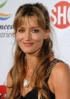 Natascha McElhone, Actress: The Truman Show. Natascha McElhone was born in Hampstead, London, England, and raised in Brighton, England, by journalist parents. She has several brothers but is the only girl. She took lessons in Irish dancing from age of six to 12. She attended St. Mary's Hall School for Girls in Brighton, East Sussex, from 1982-1986. Her family now resides in a small town in Ireland...