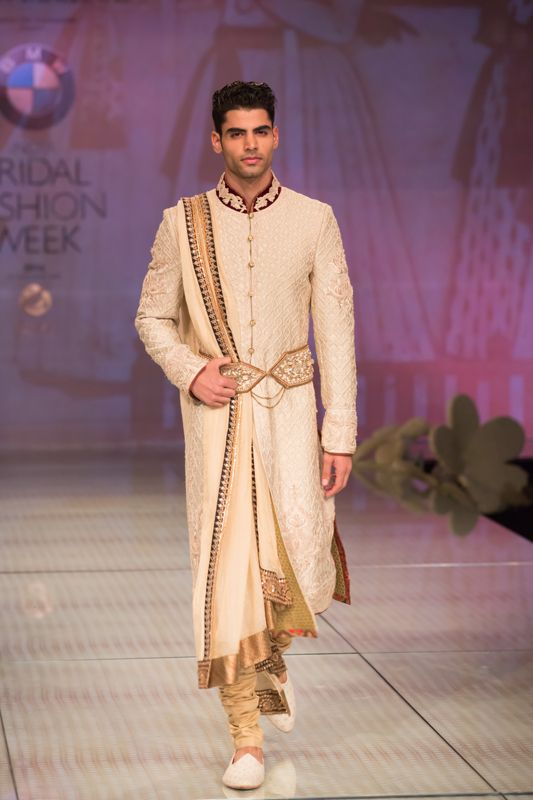 Tarun Tahiliani cream groom kurta. More here: http://www.indianweddingsite.com/bmw-india-bridal-fashion-week-ibfw-2014-tarun-tahiliani-show/
