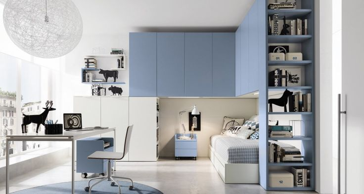Multispace / Z324  Monopoli: bridging wardrobe and bookcase link system in light blue floor elements in thermally-structured melamine white oak with open pore. Scriba: desk thermally-structured melamine white oak with open pore with drawers in light blue. Zed line: shelves in white and light blue. Minimal: bed thermallystructured melamine white oak with open pore.