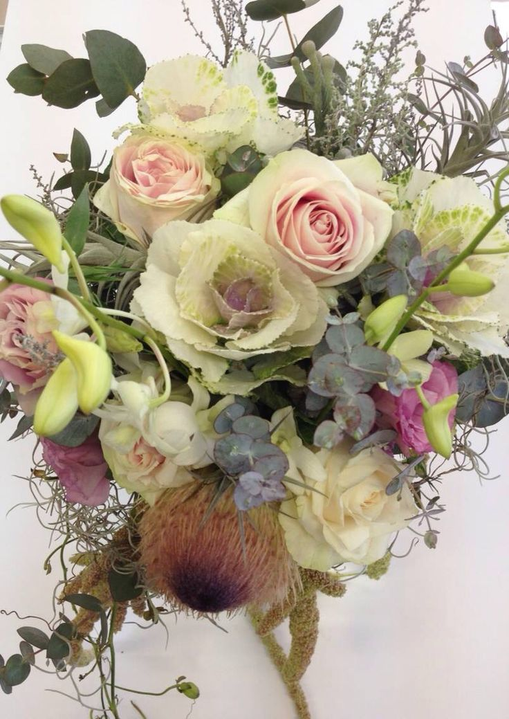 Wedding bouquet of debdrobium orchids, Kale flowers, blush pink roses, and insides of proteas by www.creativenook.co.za