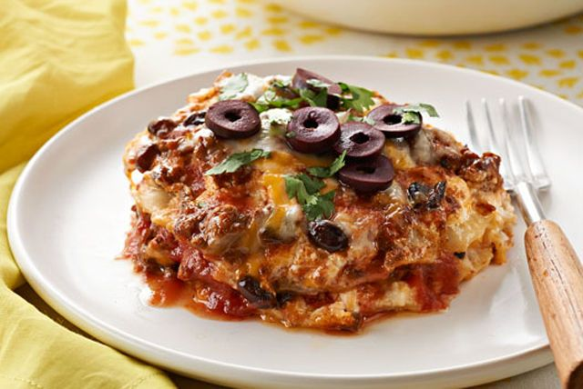 The good news for the family is that they're having both enchiladas and lasagna tonight. The great news for you: It's an easy slow-cooker recipe.