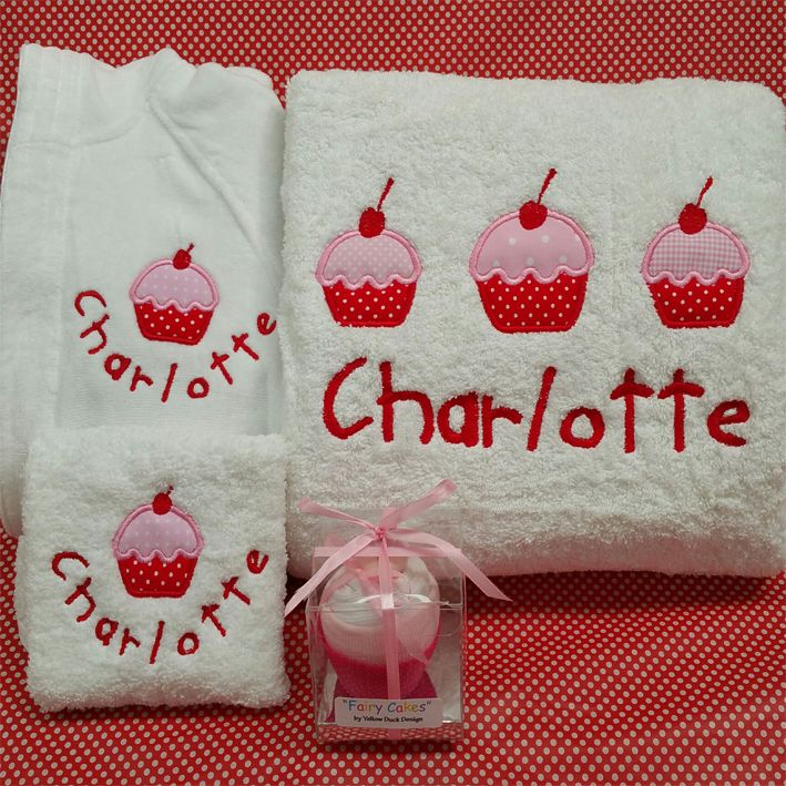 Gorgeous personalised baby bath towel, robe and face cloth set along with a cute little baby cup cake made from singlets and socks.