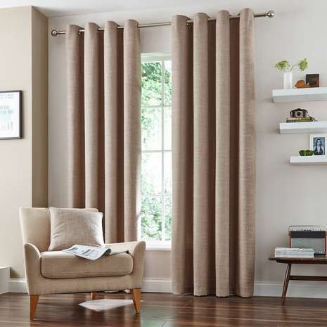 Crafted with a linen textured effect and an elegant natural colourway, this pair of ready made curtains feature lining to reduce unwanted draughts from entering...