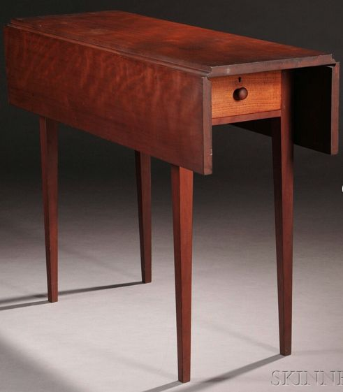 Shaker Cherry and Butternut Drop-leaf Table, Sister's shop, Canaan, New York, early 19th century, rectangular overhanging drop-leaf top on a straight apron with two scratch-beaded drawers, one on each side, with turned wooden pulls, supported on square tapering legs, old mellow surface, ht. 28, closed wd. 13, open wd. 27 1/4, lg. 36 in.