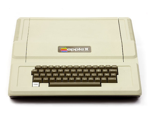 Apple II- Steve Wozniak designed the Apple II in 1977. The self-contained unit housed electronics, keyboard and power supply, with the BASIC language in permanent memory. A TV served as the display. The floppy disk drive (1978) and spreadsheet program VisiCalc (1979) made it a blockbuster.