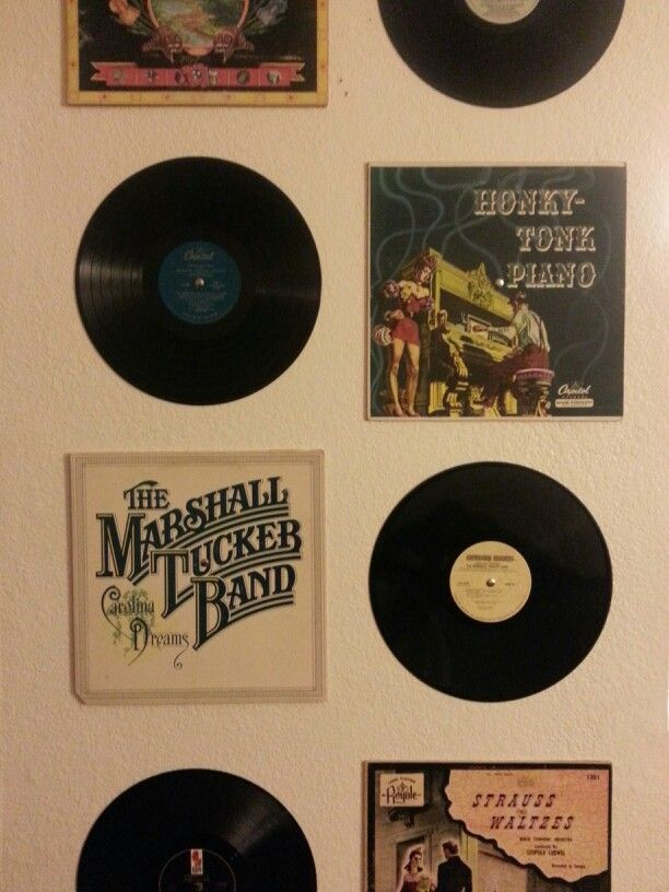 Made this today :] cheap thrift store vinyl records at 50 cents a piece and tacks. Fun way to decorate a wall on the cheap!! could be great for a college dorm room