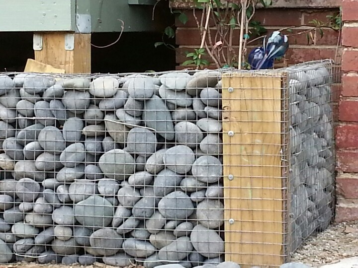 Gabion raised bed http://www.gabion1.co.uk. makes me think i could use chicken wire or fence