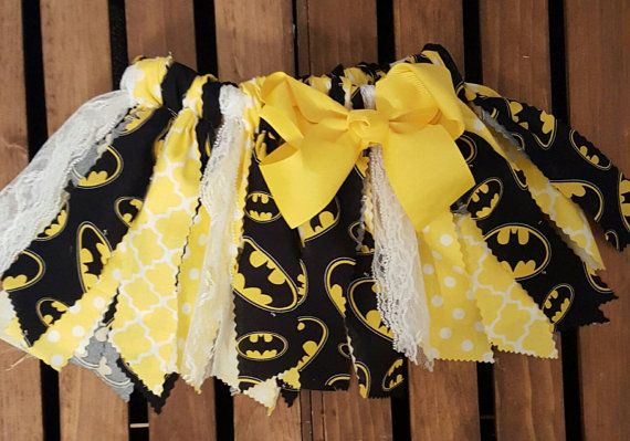This listing features a handcrafted scrappy fabric tutu. This fabric tutu is Batman Super hero fabric tutu. Made with yellow and black fabric