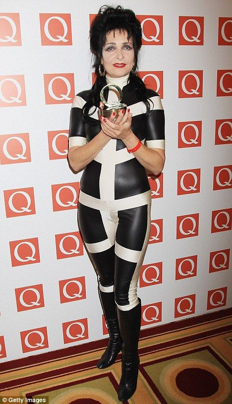 'I'm not dead!' Siouxsie Sioux shows off her trim figure in a rubber jumpsuit at the Q Awards in London