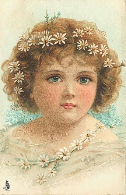 Sweet girl with daisies in her hair