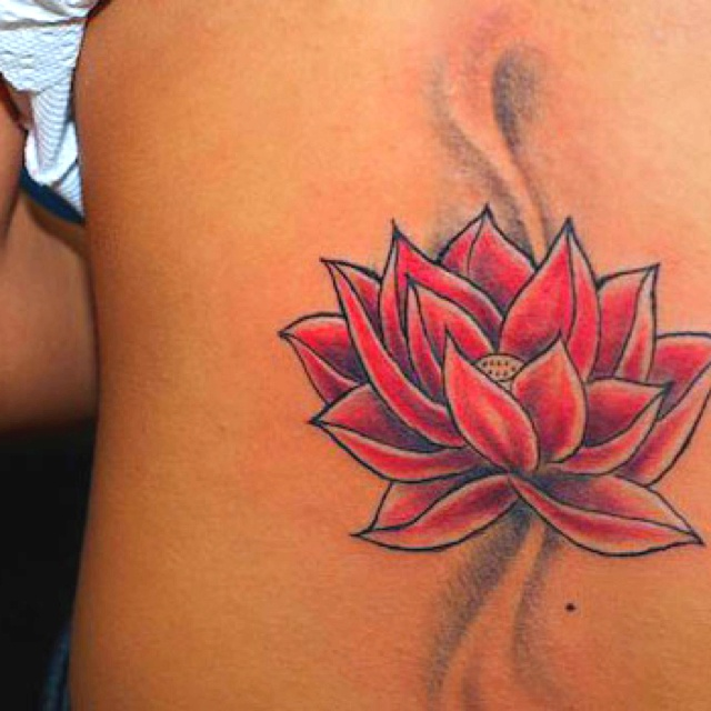 Awesome lotus tattoo. I like the flow of it