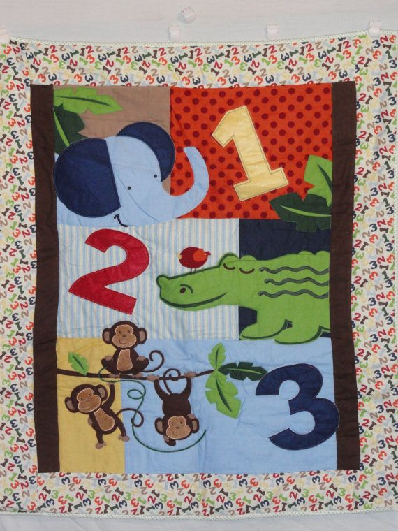 1 2 3 Counting Jungle Animals Baby Quilt in Bold colors, Blue, Green and Orange, Applique animals. $66.00, via Etsy.
