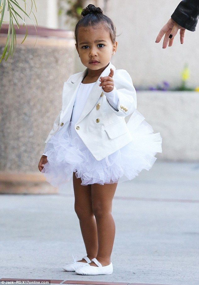 Designer ballerina: The toddler was dressed in a white tutu and custom-made Balmain jacket