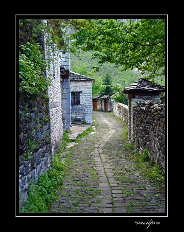 Stone street of famous village in Zagorohoria is Papigo, Ioannina, Epirus_ Greece