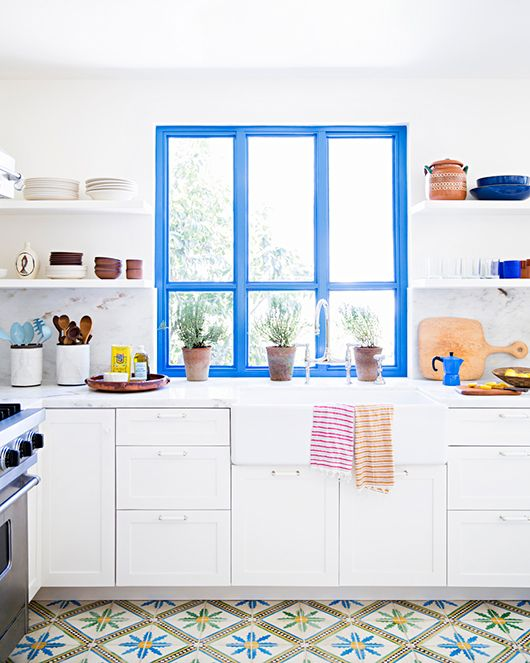 white kitchen with open shelving, awesome tile and blue accent window frame / brittany ambridge / sfgirlbybay