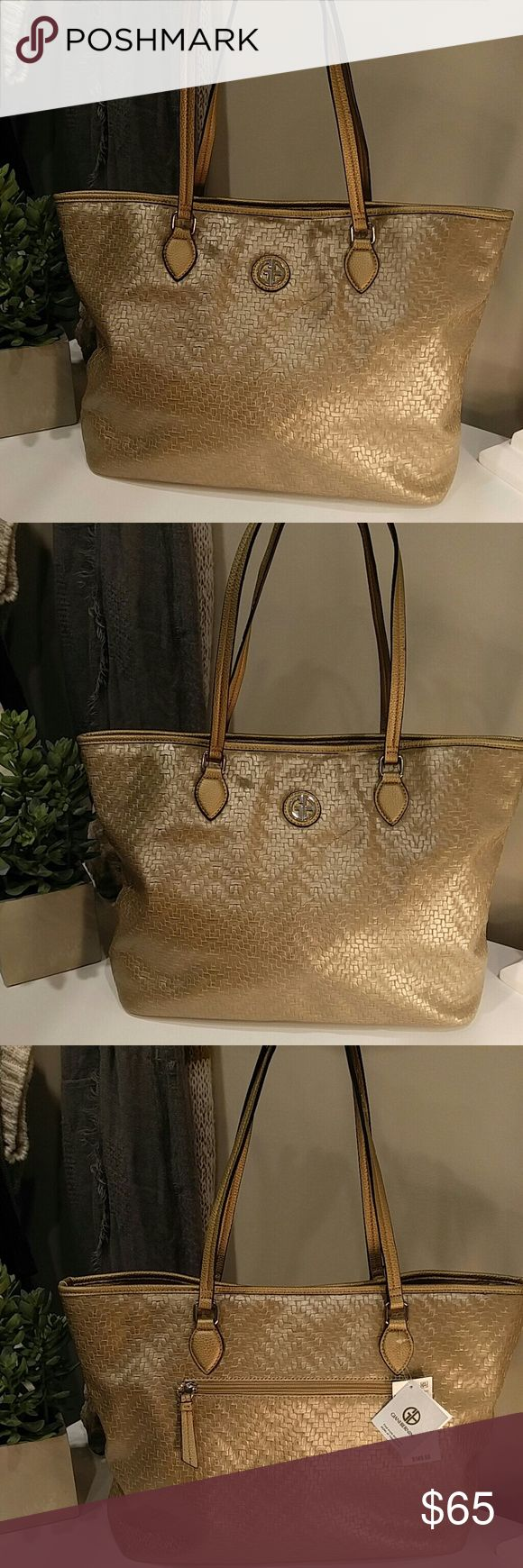 "NWT GIANI BERNINI BRONZE LEATHER WEAVED BAG $149.50 100% Authentic GIANI BERNINI LEATHER BRONZE Tote Bag Silver Tote Bag  Measurements: 14.5"" L x  11.75"" H x 4.75"" W  Dual straps with 10"" drop   Exterior:  Made of saffiano bronze leather  Front Giani Bernini Plaque  Rear zip pocket  2 Magnetic Snap Closures and 1 middle zip closure  Interior:  Khaki Satin lining & Silver Faux Leather Trimming  One  Zip Pocket  One Slip Pocket  Giani Bernini plaque on the inside Giani Bernini Bags Totes"