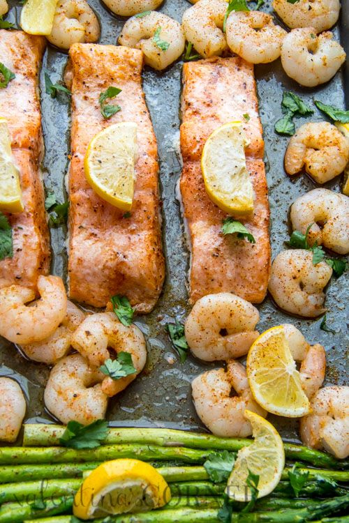 Busy nights call for #easydinner recipes like this One-Pan Baked Shrimp, Salmon and Asparagus dish. The food is delicious and clean up is a breeze!