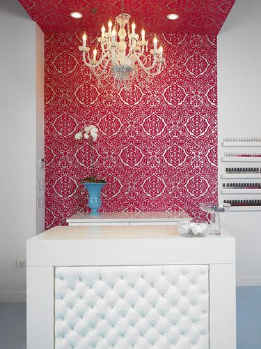 I like the idea of a different designed wallpaper behind the front desk of a spa!