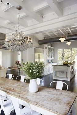Farm table goodness with modern white chairs.