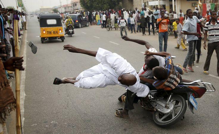 Bike hits man in Nigeria - http://www.seethisordie.com/perfecttiming/bike-hits-man-in-nigeria/ #perfect #shot #photo #funny #perfecttiming