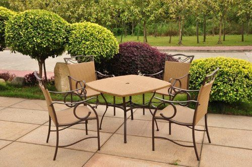 """Valencia Resin Wicker / Steel Set of Five (Matte Brown) (39""""W x 29""""H x 39""""D) by International Caravan. Save 32 Off!. $519.00. The light pecan resin wicker and steel frame are weather resistant. The table has a center hole for an umbrella. Color: Matte Brown. The pieces in this outdoor wicker furniture set have sturdy metal frames finished in matte brown. Size: 39""""W x 29""""H x 39""""D. The Valencia Resin Wicker / Steel Set of Five is perfect for enhancing your outdoor space! This five p..."""