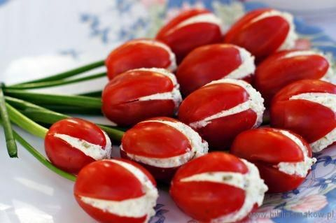 Tomato Tulips  13 large cherry or small Roma tomatoes   14 stalks of green onions or chives for the stems   200g farmers cheese or cottage cheese for filling (or you could use goat cheese, egg or chicken salad)   1 cucumber   1/2 teaspoon dried basil   Salt and pepper