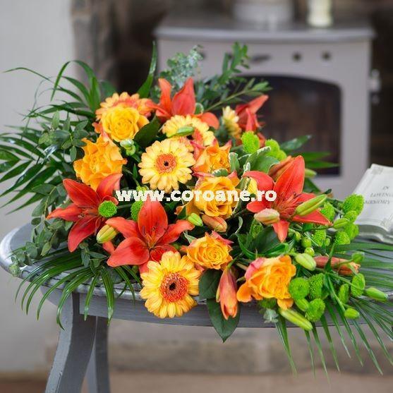 Jerba funerara crini portocalii si gerbera, o jerba aranjata sub forma unui buchet lacrima, realizat din cele mai proaspete flori de crini portocalii, gerbera, crizanteme si trandafiri proaspeti. Asiguram livrare buchete si jerbe funerara oriunde in Romania.