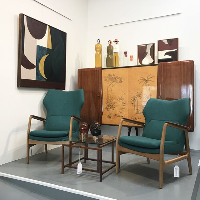On the plinth this week; stunning rosewood and maple Italian sideboard. Edith and Karen armchairs by Bovenkamp in new wool upholstery. Paired with a highly sort-after side table by Henning Norgaard. Featuring a sleek geometric rosewood frame and glass top. Artworks by #hannahnowlan, glass bonsai's by #amandadziedzic and wooden sculptures by #markalsweiler. Shop these pieces in store and online. #shopmoderntimes #moderntimesfitzroy #midcenturydesign #midcenturymodern #danishdesign