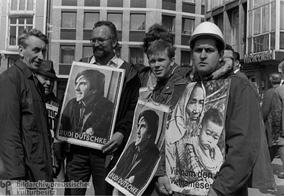 A Demonstration following the Attempted Assassination of Rudi Dutschke (April 1968)-On April 11, 1968, Josef Bachmann, a 23-year-old unskilled laborer and member of a right-wing political party, approached Rudi Dutschke on a West Berlin street in broad daylight and, after confirming his identity, shot him three times in the head and chest. Dutschke suffered life-threatening brain injuries and barely survived. After the assassination attempt, which took place on Holy Thursday, demonstrators…