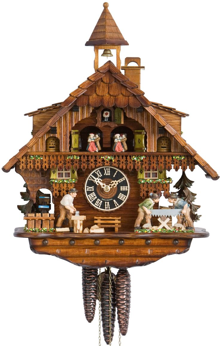 traditional cuckoo clock with beautiful ornaments made of wood for wall accessories ideas