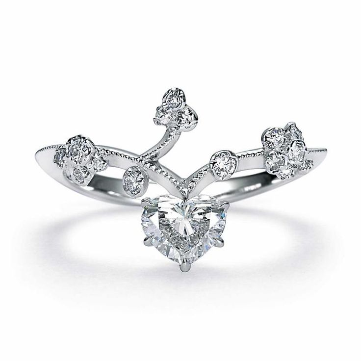 Kataoka Bleeding Heart diamond ring in 18 carat white gold, set with a heart-shape diamond in a fairytale style setting, for an unusual take on the classic engagement ring. http://www.thejewelleryeditor.com/bridal/interview/interview-yoshinobu-kataoka-engagement-rings/ #bridal