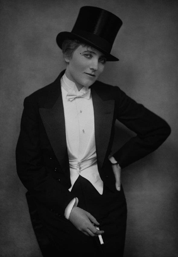 Notorious London vampire and esteemed private detective Miss Gina Perkins enjoyed scandalising Victorian human society by dressing as a man and smoking cigarettes.