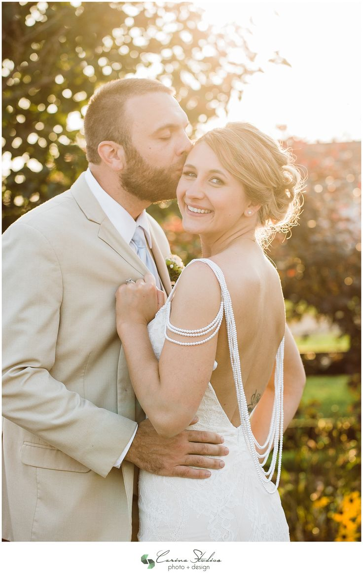 Beautiful pearl details on an Impression Bridal wedding dress from David's bridal.  Draping pearls make this gorgeous bride glow at her rustic outdoor wedding