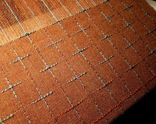 Deannas Weaving - supplemental warp and weft fading in and out of plain weave ground.