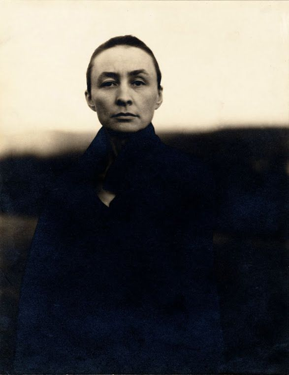 O'Keeffe, by Stieglitz  Famous for her paintings of desert bones  and flowers in abstract form. A tough old bird.