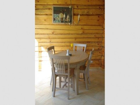 Kitchen Interior. Natural wood chairs, wood table with Granit top