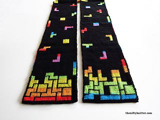 Tetris is one of my all time favorite games. Something about how the blocks fit together speaks to me. I designed the Tetris Prism Scarf to feature a Tetris game on both ends, with falling blocks along the length of the scarf. Each end has two different possible designs you can choose to knit, for either a well played game or a poorly played game! I imagine it as two people playing a Tetris battle.