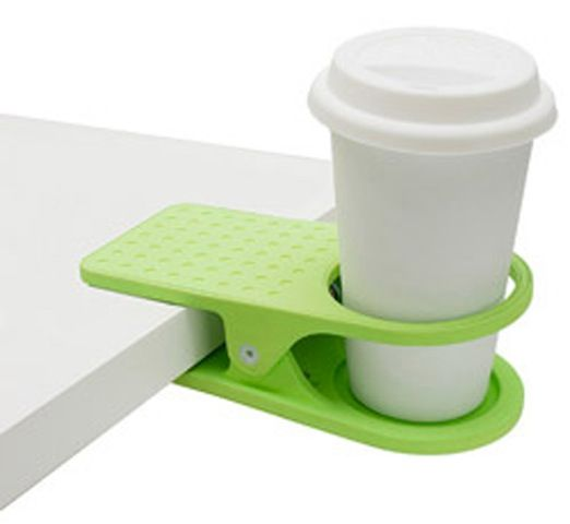 A clip on cup holder for your dorm room, makes space on a desk or chair.