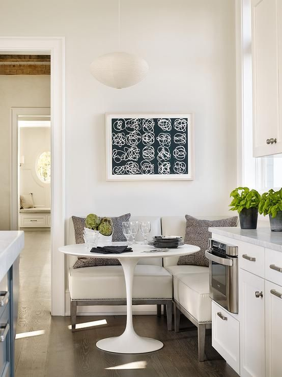 Transitional kitchen features an eat-in kitchen boasting a freestanding L shaped banquette ...