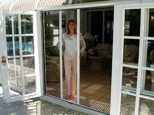 Since I don't like sliding doors, this might be a nice way to keep the bugs out of the house! ~Retractable Screens for French Patio Doors