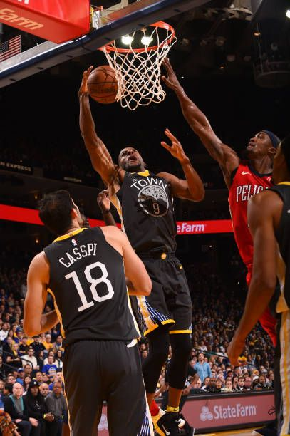 Andre Iguodala of the Golden State Warriors goes to the basket against the New Orleans Pelicans on November 25 2017 at ORACLE Arena in Oakland...