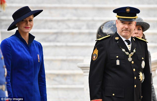 Charlene, 39, and Albert, 59, posed with twins Prince Jacques and Princess Gabriella, both two, on the palace balcony in Monaco. The mother-of-two teamed her dress with a dramatic hat.