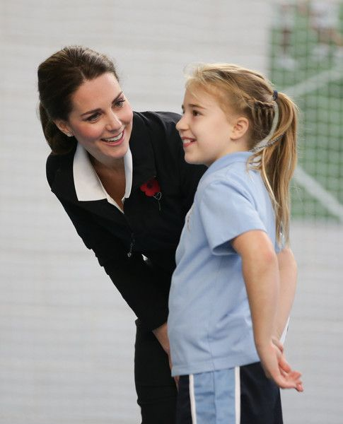 Kate Middleton Photos - Catherine, Duchess of Cambridge, talks with a girl as she takes part in a Tennis for Kids session during a visit at the Lawn Tennis Association (LTA) at the National Tennis Centre on October 31, 2017 in southwest London, England. The Duchess of Cambridge, who became Patron of the LTA in December 2016, visited the LTA, the national governing body of tennis in Great Britain, where she was briefed on the organisations latest activities and objectives, and had the…