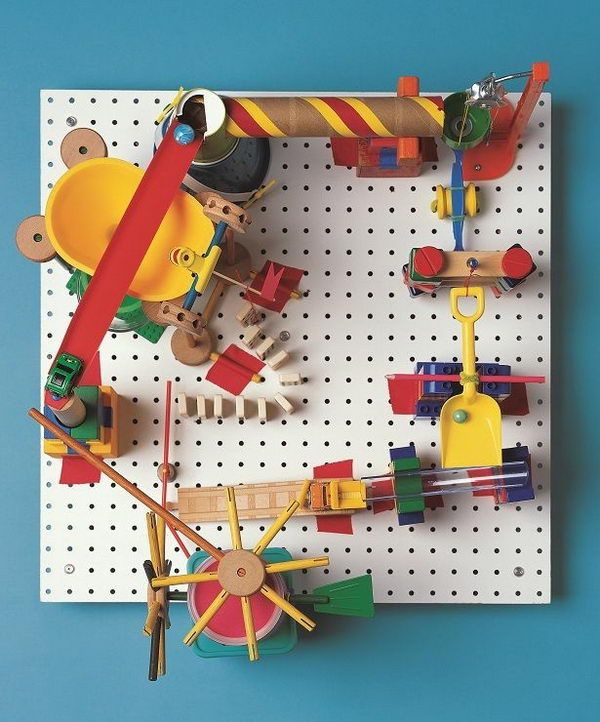 DIY Marble Run Craft - This peg-board marble run involves creating a clacking, whacking gumball machine that runs without electricity, all with parts found in the kitchen and toy box. A complete operation tutorial was provided. 16 Cool Rube Goldberg Machine Ideas, http://hative.com/rube-goldberg-machine-ideas/,