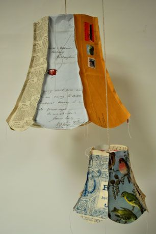 Upcycled lampshades with random book pages and old letters. Just Think of the endless childrens books you could do this with.