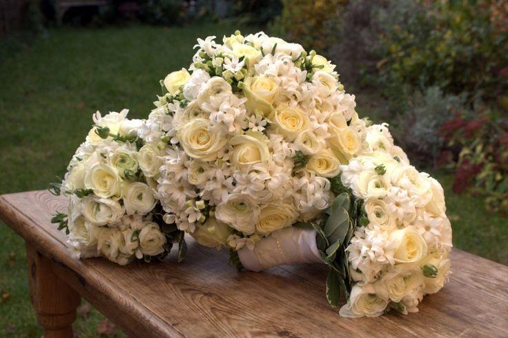 Sweet fragrant hyacinths enhance cream roses, freesia & ranunculas