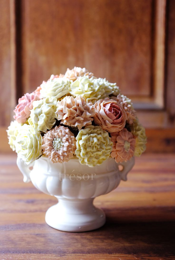 cupcake bouquet. detailed flower piping on each cupcake :)