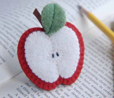 free pdf tutorial and pattern for a felt apple brooch - I'm much more likely to sew it up as a play food apple slice than a brooch!